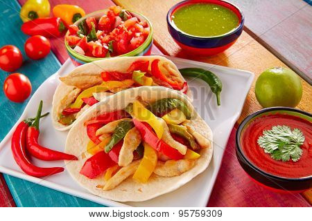 Chicken fajitas tacos mexican food guacamole pico de gallo chili peppes sauces
