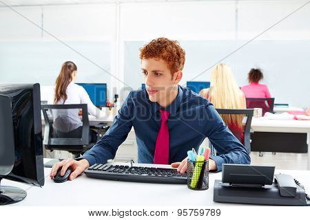 Executive young businessman working computer at offcie desk