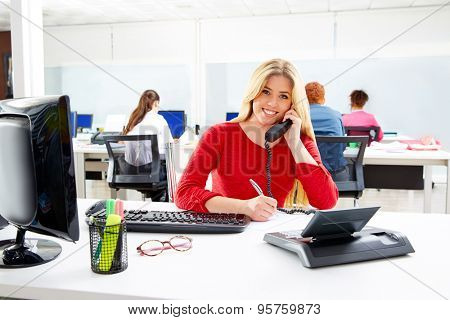 Blond business woman in call center working office with telephone call at desk