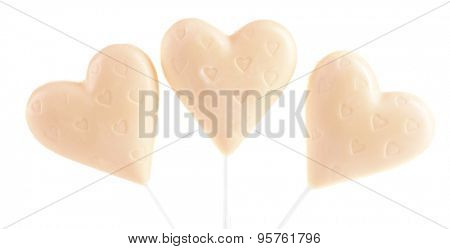 Tasty candies in shape of hearts isolated on white