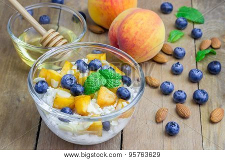 Fresh Cottage Cheese With Peach, Blueberry, Almonds And Honey. Concept Of Healthy Eating For Breakfa
