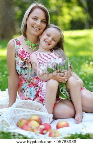 happy young mother with girl in park