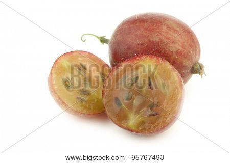 gooseberry and a cut one (Ribes uva-crispa) on a white background