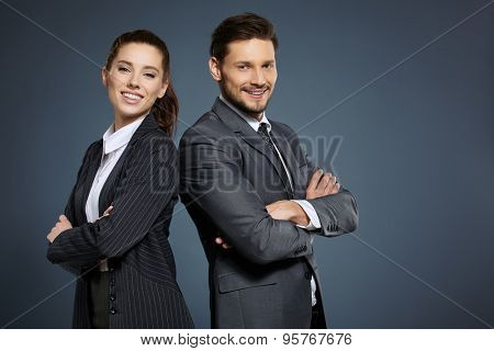 Business couple on blue background