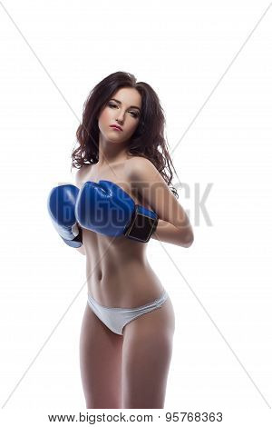 Sexy brunette posing topless in boxing gloves