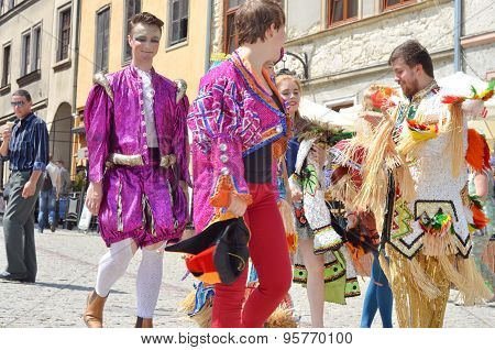 People in Carnival costumes in the street