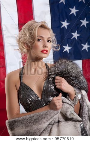 Young Woman In Fur Coat And American Flag