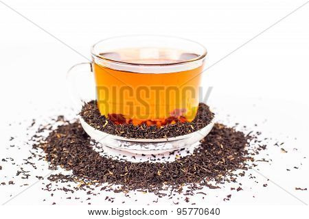 cup of tea and dry tea leaves scattered around