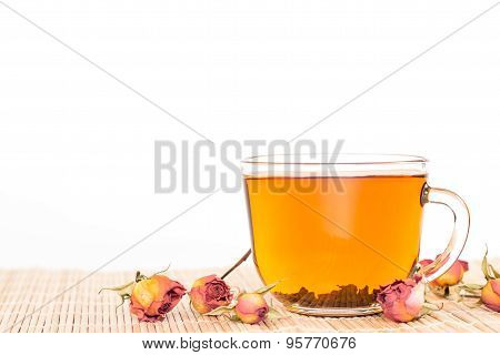 cup of tea and withered flower on wooden background