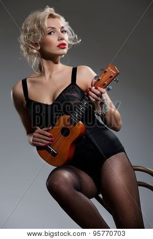Young Woman With Ukulele