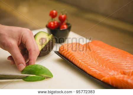 Cutting the salmon with a knife