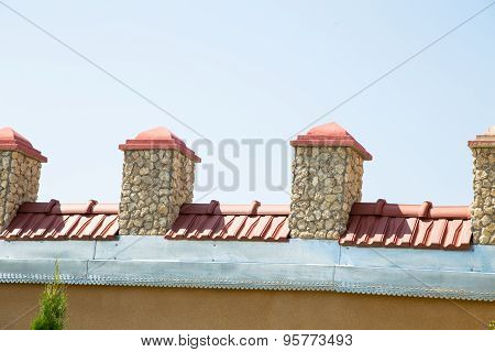 Rooftop against blue sky.
