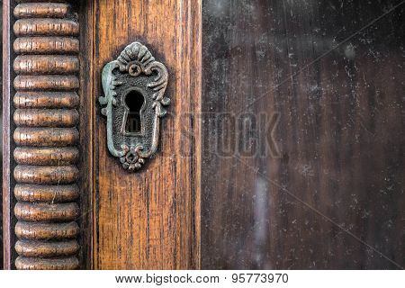 Keyhole of antique wooden cabinet