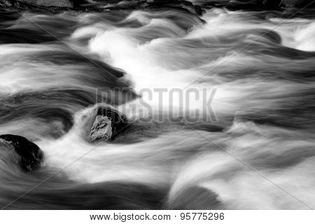 Fast flowing mountain stream and rocks