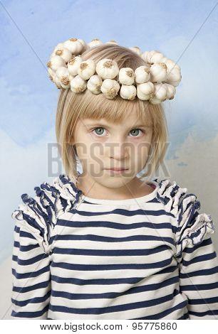Little Girl With Garlic Wreath On Her Head