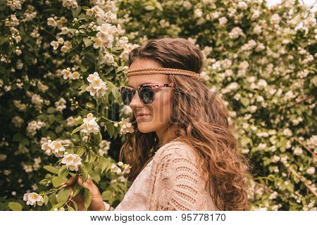 Profile Portrait Of Happy Hippie Young Woman Among Flowers
