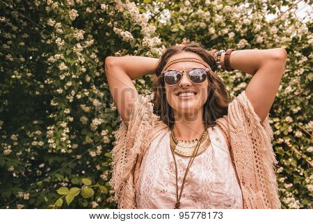 Portrait Of Smiling Boho Young Woman Among Flowers