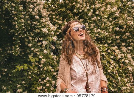 Bohemian Young Woman Among Flowers Looking Up On Copy Space