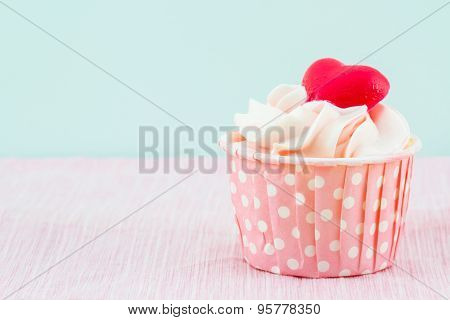 Colorful Of Sweet Cup Cake On Fabric Background.