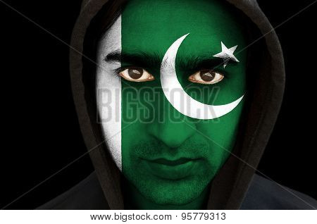 Man with Pakistani flag face paint