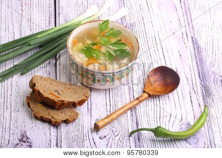 Soup With Pelmeni Submitted To A Soup Tureen, Bread Both Green Onions And A Wooden Spoon