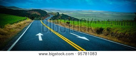 Street With Arrows Painted On The Surface. Scenic View