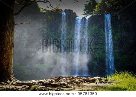 Wangarai Waterfall With Pond. Mist Is Drifting Into The Forest