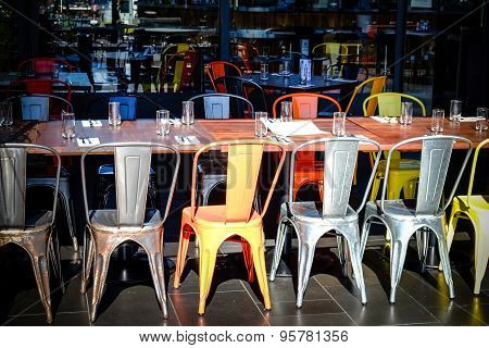 Row Of Chairs And Tables In An Empty Restaurant