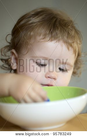 Portrait Of Independent Boy Eating