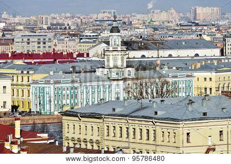 ST. PETERSBURG, RUSSIA - MARCH 5, 2015: Building of Kunstkamera and the cityscape viewed from the colonnade of St. Isaac's cathedral. Built in 1727, the Kunstkamera is the first Russian museum