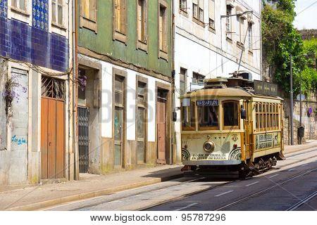 PORTO, PORTUGAL - JUNE, 12: Old tram in the old city on June 12, 2015 in Porto, Portugal
