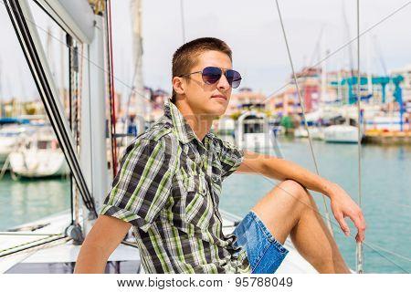 Beard sailor man in port on yacht