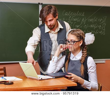 Teacher And Student In The Classroom Calculus.