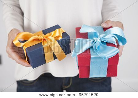 Two Gifts In Woman Hands