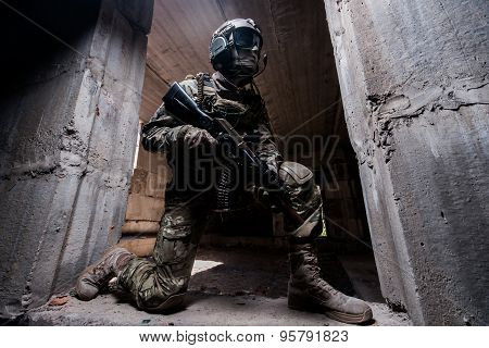 Soldier Hiding In A Concrete Behind Cover Where Kneeling In The Doorway With A Gun In His Hand