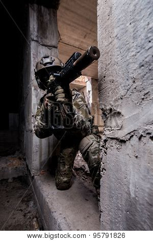 Russian Army Soldier Shoots A Machine Gun Out Of Hiding In An Abandoned Building