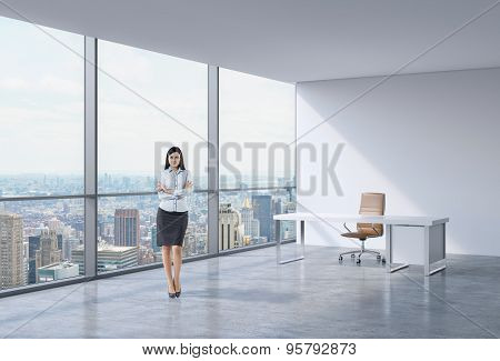 Full-length Of A Brunette Business Woman In A Workplace At Modern Panoramic Office In New York, Manh