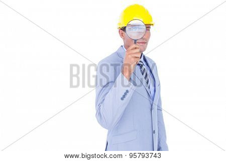 businessman with helmet and magnifier on white background