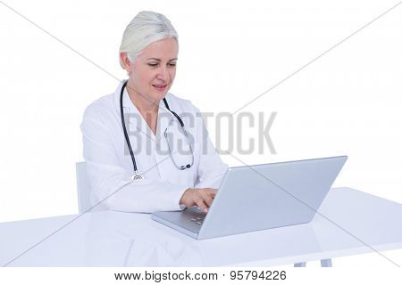 Doctor working on her laptop and calling on a white scree