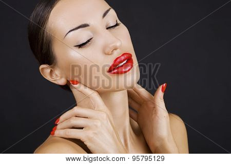 Beautiful Sexy Young Girl With Red Lips And Red Nail Polish, Bright Make-up On Dark Background (blac