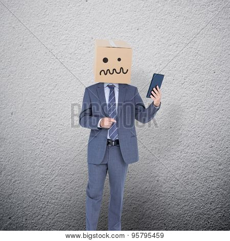Anonymous businessman against grey wall