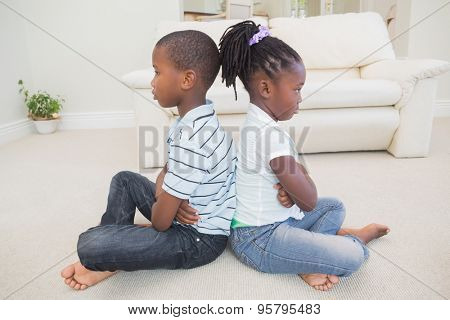 Siblings not talking to each other at home in the living room