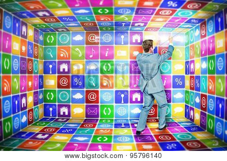 Businessman presenting with hands against app room