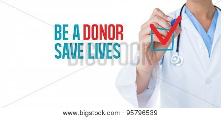 Doctor pointing felt pen against be a donor save lives