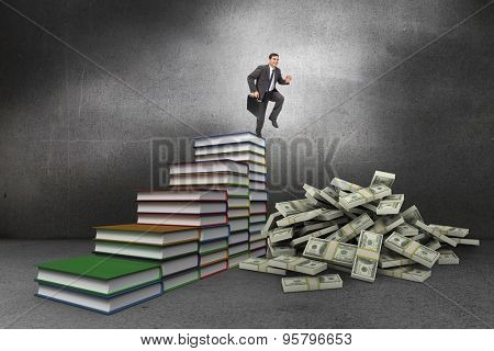 Cheerful businessman in a hurry against steps made from books in grey room