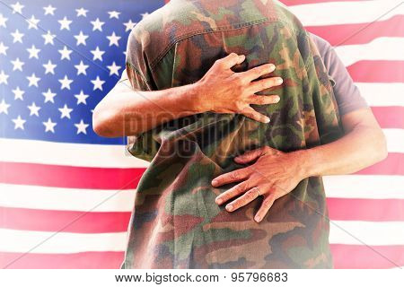 Solider reunited with father against rippled us flag