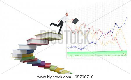 Happy businessman leaping with his briefcase against steps made out of books