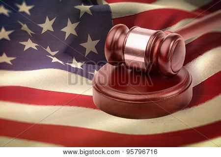 Hammer and gavel against weathered surface