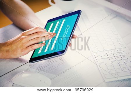 Woman using tablet at work against online banking
