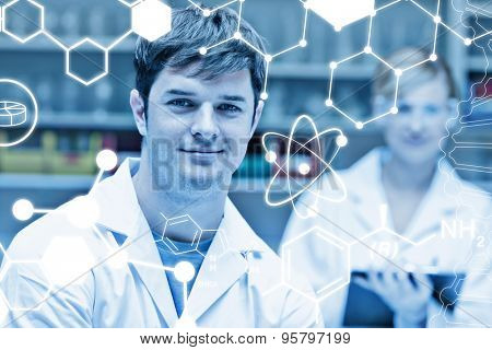 Science graphic against two concentrated scientists looking at the camera